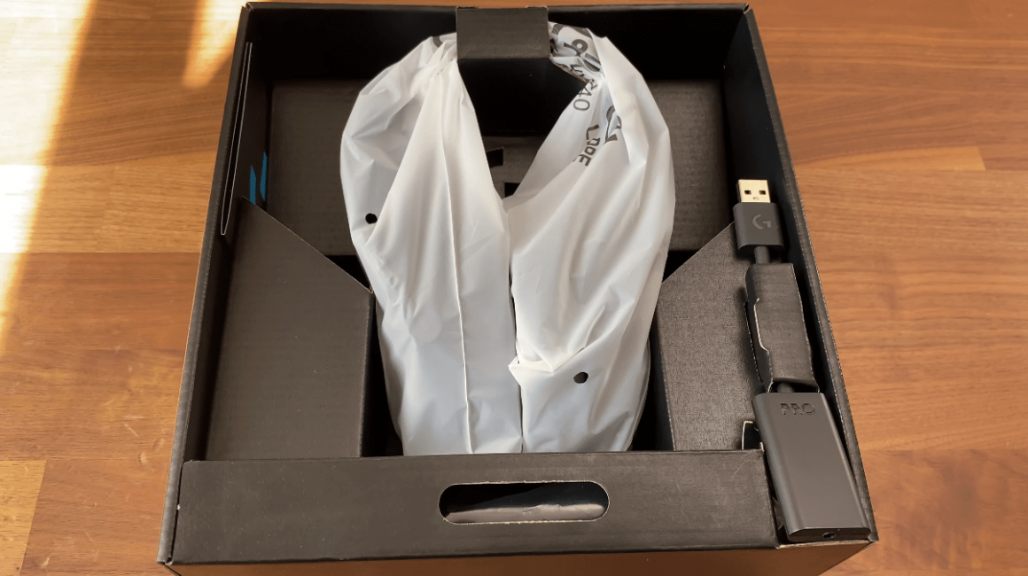 Opening the Pro X Box shows the headset wrapped and DAC beside it
